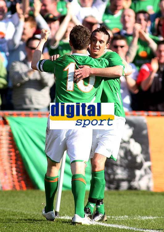 Photo: Paul Thomas.<br /> Republic of Ireland v Wales. European Championships 2008 Qualifying. 24/03/2007.<br /> <br /> Goal scorer Stephen Ireland (R) is congratulated by Robbie Keane.
