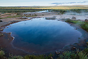Bioluminescent, geothermal pools next to the Strokkur geyser, in Thingvellir National Park, Iceland.