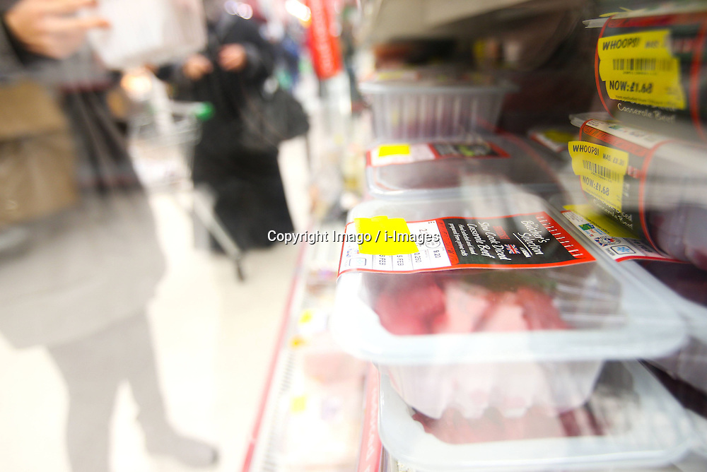 Label of special offer are seen on boxes of fresh meat at an Asda supermarket in London, capital of Britain, Feb. 15, 2013. Asda has withdrawn its fresh beef bolognese sauce after tests for horse DNA came back positive. It is the first time since the horsemeat scandal unfolded that horse DNA has been found in fresh produce., February 15, 2013. Photo by Imago / i-Images...UK ONLY