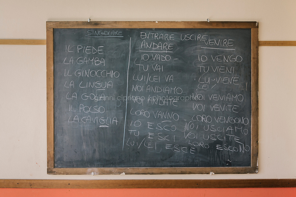 COMO, ITALY - 21 JUNE 2017: A blackboard used for Italian lessons for the migrants hosted in the center ran by the priest Giusto della Valle, is seen here in Como, Italy, on June 21st 2017.<br /> <br /> Residents of Como are worried that funds redirected to migrants deprived the town&rsquo;s handicapped of services and complained that any protest prompted accusations of racism.<br /> <br /> Throughout Italy, run-off mayoral elections on Sunday will be considered bellwethers for upcoming national elections and immigration has again emerged as a burning issue.<br /> <br /> Italy has registered more than 70,000 migrants this year, 27 percent more than it did by this time in 2016, when a record 181,000 migrants arrived. Waves of migrants continue to make the perilous, and often fatal, crossing to southern Italy from Africa, South Asia and the Middle East, seeing Italy as the gateway to Europe.<br /> <br /> While migrants spoke of their appreciation of Italy&rsquo;s humanitarian efforts to save them from the Mediterranean Sea, they also expressed exhaustion with the country&rsquo;s intricate web of permits and papers and European rules that required them to stay in the country that first documented them.