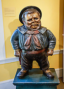 "This image of Jack Tar first appeared after 1841, when the US Navy regulated its uniforms for the first time, with shore leave uniform of open jacket, red neckerchief, black shoes, and black brimmed hat. This ""Jack Tar, Mid-19th century"" carved and painted wood trade sign originally stood outside a San Francisco ships' chandler shop, which sold navigational instruments and naval supplies. It was later used as a cigar store figure in San Jose, California. Hats water-proofed with tar or dark paint gave the ordinary sailor the nickname ""Jack Tar."" Shelburne Museum is one of the finest, most diverse, unconventional museums of American folk art. Visit this extensive museum in the town of Shelburne, near Lake Champlain, in Vermont, USA. Over 150,000 works are exhibited in 38 buildings, 25 of which are historic (relocated from New England and New York). See impressionist paintings, American paintings, artifacts of the 1600s-1900s, folk art, quilts and textiles, carriages, furniture, a lighthouse, covered bridge, and 220-foot steamboat Ticonderoga. Electra Havemeyer Webb, an avid collector of American folk art, founded the Museum in 1947."