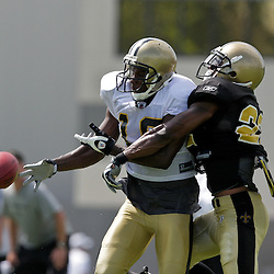 01 August 2009: New Orleans Saints cornerback Tracy Porter (22) breaks up a pass intended for wide receiver Devery Henderson (19) during New Orleans Saints training camp at the team's practice facility in Metairie, Louisiana.