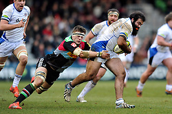 Kane Palma-Newport of Bath Rugby is tackled in possession - Photo mandatory by-line: Patrick Khachfe/JMP - Mobile: 07966 386802 31/01/2015 - SPORT - RUGBY UNION - London - The Twickenham Stoop - Harlequins v Bath Rugby - LV= Cup