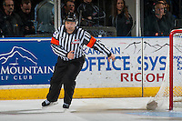 KELOWNA, CANADA - JANUARY 7: Referee Chris Crich skates behind the net at the Kelowna Rockets against the Kamloops Blazers on January 7, 2017 at Prospera Place in Kelowna, British Columbia, Canada.  (Photo by Marissa Baecker/Shoot the Breeze)  *** Local Caption ***