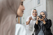 Hijabistas. Friends and fashion enthusiasts Imane Asry, Shama Vafaipour and Maryam Dinar photograph each other in the streets of Söder, Stockholm.