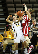 19 February 2009: Wisconsin guard Alyssa Karel (30) and Iowa guard Kristi Smith (11) run into each other during the first half of an NCAA women's college basketball game Thursday, February 19, 2009, at Carver-Hawkeye Arena in Iowa City, Iowa. Iowa defeated Wisconsin 72-65.