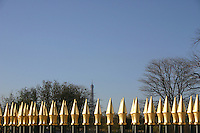 Gold topped railings in Tuileries gardens, Eiffel Tower in Background, Paris, France<br />