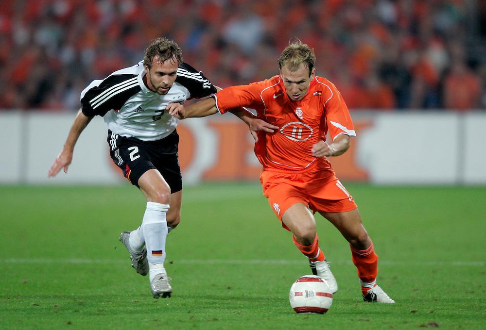 Holland. Rotterdam. 17/08/05. Holland-Germany. Arjen Robben (R) Andreas Hinkel. Photo: Gerrit de Heus