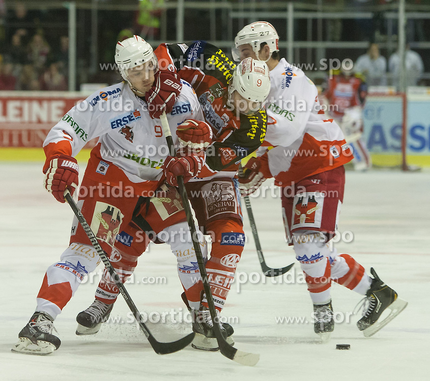05.01.2014, Stadthalle, Klagenfurt, AUT, EBEL, KAC vs HC Bozen, 64. Runde, im Bild Rick Schofield (HC Bolzano, #9), Tylor Spurgeon (Kac, #9), Matt Tomassoni (HC Bolzano, #27) // during the Erste Bank Icehockey League 64th Round match betweeen EC KAC and HC Bozen at the City Hall, Klagenfurt, Austria on 2014/01/05. EXPA Pictures © 2014, PhotoCredit: EXPA/ Gert Steinthaler