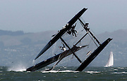 A sailor plunges into the wing an Oracle Racing AC45 boat after it capsized during an exhibition race to advertise the 34th Annual America's Cup in San Francisco Bay in San Francisco on June 13, 2011.   REUTERS/Beck Diefenbach   (UNITED STATES)