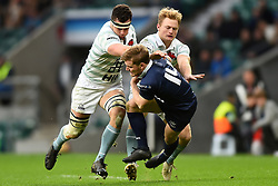 December 7, 2017 - London, England, United Kingdom - Oxford University Ed David gets tackled by Cambridge University Andrew Hunter during the Mens Varsity match between Oxford University  and Cambridge University  at Twickenham Stadium, London, England on 7 Dec 2017. (Credit Image: © Kieran Galvin/NurPhoto via ZUMA Press)