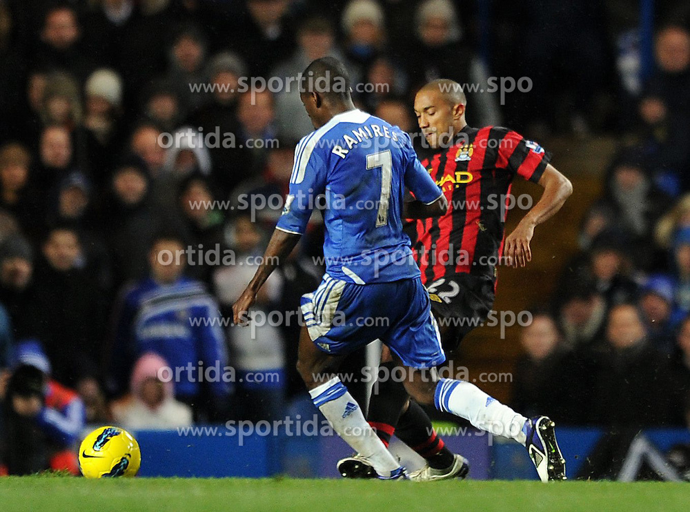 12.12.2011, Stamford Bridge Stadion, London, ENG, PL, FC Chelsea vs Manchester City, 15. Spieltag, im Bild Manchester City's Gael Clichy is shown a second yellow card for this foul on Chelsea's Ramires during the football match of English premier league, 15th round, between FC Chelsea and Manchester City at Stamford Bridge Stadium, London, United Kingdom on 2011/12/12. EXPA Pictures © 2011, PhotoCredit: EXPA/ Propagandaphoto/ Chris Brunskill..***** ATTENTION - OUT OF ENG, GBR, UK *****