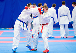 Luka Debersek (blue) of Slovenia fighting against Team of Ukraine (red) during of Kumite Team male at Day Two of Karate 1 World Cup - Thermana Slovenia Lasko 2014 tournament, on March 16, 2014 in Arena Tri Lilije, Lasko, Slovenia.Photo by Vid Ponikvar / Sportida