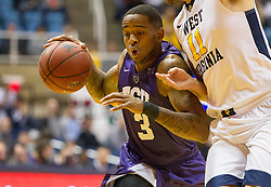 Feb 13, 2016; Morgantown, WV, USA; TCU Horned Frogs guard Malique Trent (3) drives against West Virginia Mountaineers forward Nathan Adrian (11) during the first half at the WVU Coliseum. Mandatory Credit: Ben Queen-USA TODAY Sports