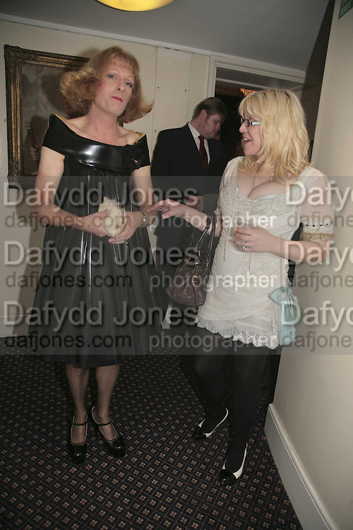 PRESENTER OF LAST YEAR'S PRIZE GRAYSON PERRY AND THIS YEAR'S PRESNETER COURTNEY LOVE, Literary Review's Bad Sex In Fiction Prize.  In &amp; Out Club (The Naval &amp; Military Club), 4 St James's Square, London, SW1, 29 November 2006. <br />Ceremony honouring author who writes about sex in a 'redundant, perfunctory, unconvincing and embarrassing way'. ONE TIME USE ONLY - DO NOT ARCHIVE  &copy; Copyright Photograph by Dafydd Jones 248 CLAPHAM PARK RD. LONDON SW90PZ.  Tel 020 7733 0108 www.dafjones.com