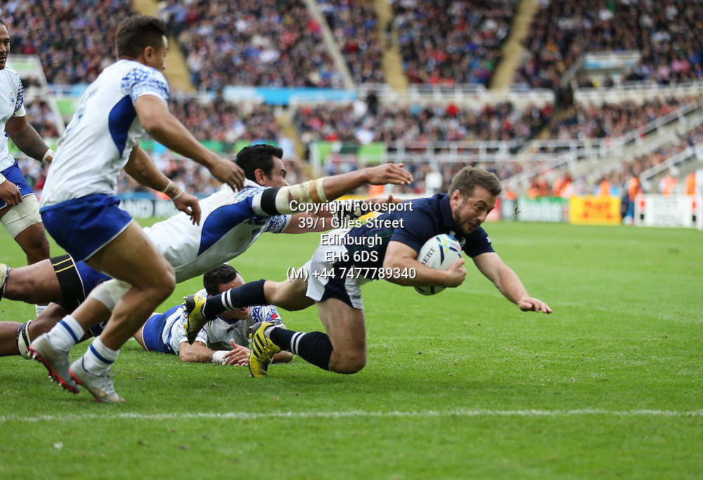 Greig Laidlaw - Scotland captain crashes over the line for the match winning try late in the game to take Scotland into the quarter finals of the Rugby World Cup.<br /> Scotland v Samoa, Rugby World Cup, Pool B, St James' Park, Newcastle, England, Saturday 10 October 2015<br /> ***PLEASE CREDIT: FOTOSPORT/DAVID GIBSON***<br /> <br /> <br /> Scotland v Samoa, Rugby World Cup, Pool B, St James' Park, Newcastle, England, Saturday 10 October 2015<br /> ***PLEASE CREDIT: FOTOSPORT/DAVID GIBSON***