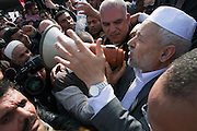 Rached Ghannouchi talk to twosands of his supporters in front of the airport..Ghannouchi, the leader of the islamic movement Ennahda, reach Tunis on January 30, 2011 after 22 years of exile in London...