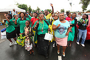 ANC Womens League gather to mourn the death and celebrate the life of Nelson Rolihlahla Mandela outside his former home in Vilakazi street in Soweto. Johannesburg. South Africa<br />