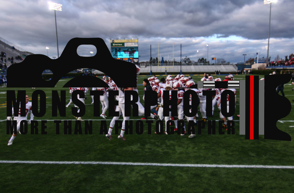 Smyrna (12-0) players run onto the field to celebrate after winning their second straight DIAA division one Football Championship defeating Top-seeded Middletown (11-1) 36-14 Saturday, Dec. 03, 2016 at Delaware Stadium in Newark.