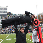 Army cheerleaders in action during the Army Black Knights Vs Air Force Falcons, College Football match at Michie Stadium, West Point. New York. Air Force won the game 23-6. West Point, New York, USA. 1st November 2014. Photo Tim Clayton