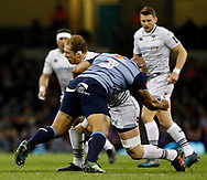 Ospreys' Alun Wyn Jones is tackled by Cardiff Blues' Taufa'ao Filise<br /> <br /> Photographer Simon King/Replay Images<br /> <br /> Guinness PRO14 Round 21 - Cardiff Blues v Ospreys - Saturday 28th April 2018 - Principality Stadium - Cardiff<br /> <br /> World Copyright &copy; Replay Images . All rights reserved. info@replayimages.co.uk - http://replayimages.co.uk