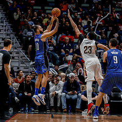 Oct 30, 2017; New Orleans, LA, USA; Orlando Magic guard Evan Fournier (10) shoots over New Orleans Pelicans forward Anthony Davis (23) during the second half of a game at the Smoothie King Center. The Magic defeated the Pelican 115-99.  Mandatory Credit: Derick E. Hingle-USA TODAY Sports