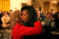 First Lady Michelle  Obama hugs Dr. Jill Biden at  a dinner for Congressional  Committee chairmen and ranking members in the East Room of the White House on March 4, 2009.  photo by Dennis Brack
