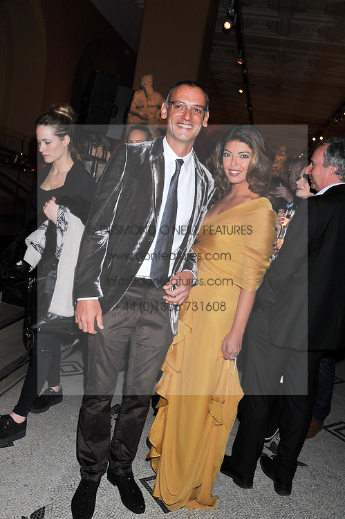 NICK GODLEY and MAYA STENDHAL at a private view of the V&A's exhibition Golden Spider Silk held at the Victoria & Albert museum, London on 24t January 2012.