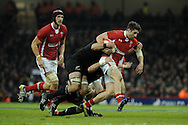 Alex Cuthbert of Wales is halted. Dove Men autumn international series, Wales v New Zealand at the Millennium stadium in Cardiff , South Wales on Saturday 24th November 2012. pic by Andrew Orchard, Andrew Orchard sports photography,