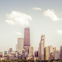 Chicago panorama photo of retro Chicago skyline with John Hancock Building and city skyscrapers. The John Hancock Center is one of the world's tallest skyscrapers and is a famous fixture in the Chicago skyline. Photo has a nostalgic vintage tone with a panoramic ratio of 1:3.