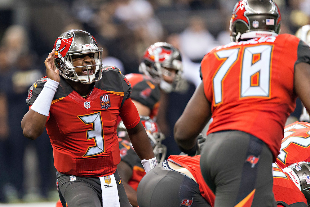 NEW ORLEANS, LA - SEPTEMBER 20:  Jameis Winston #3 hands yells to Gosder Cherilus #78 of the Tampa Bay Buccaneers during a game against the New Orleans Saints at Mercedes-Benz Superdome on September 20, 2015 in New Orleans Louisiana.  The Buccaneers defeated the Saints 26-19.  (Photo by Wesley Hitt/Getty Images) *** Local Caption *** Jameis Winston; Gosder Cherilus