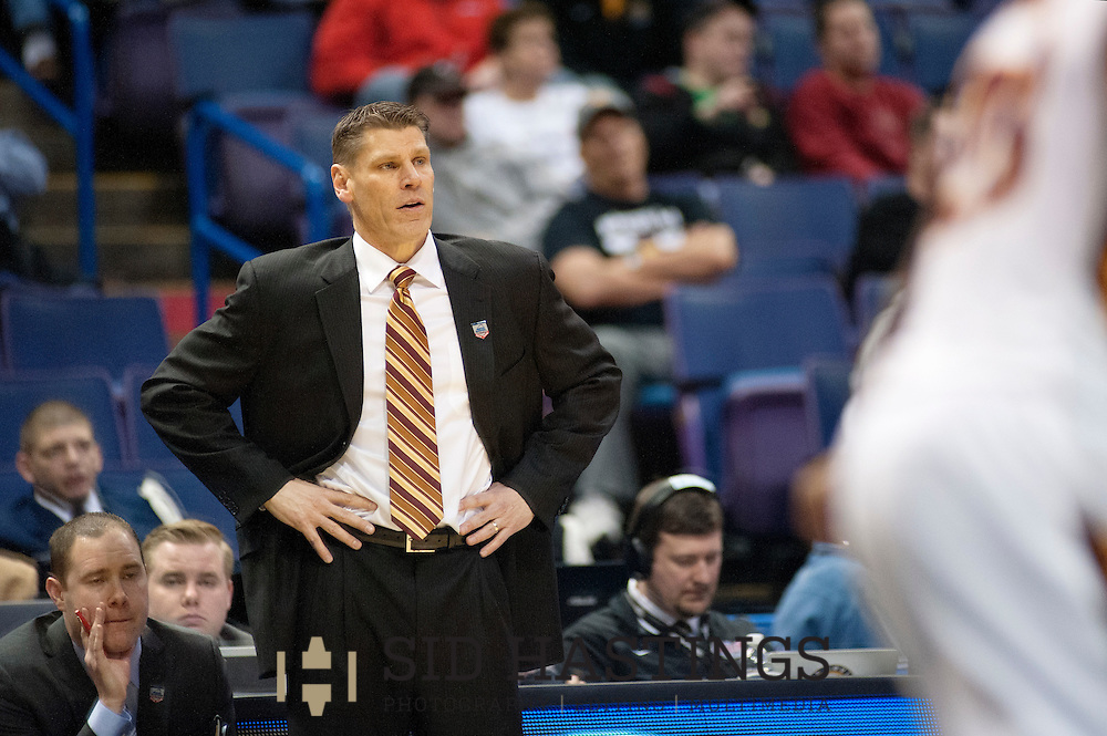 3 MARCH 2016 -- ST. LOUIS -- Loyola University Chicago's men's basketball coach Porter Moser makes a point to his during during the Ramblers game with Bradley University during the 2016 Missouri Valley Conference Arch Madness men's basketball tournament at the Scottrade Center in St. Louis Thursday, March 3, 2016. The Ramblers topped Bradley 74-66, to advance to the second round of the tournament.<br /> <br /> Photo &copy; copyright 2016 Sid Hastings.
