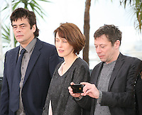 Benicio Del Toro, Gina McKee and actor Mathieu Amalric taking a photo at the Jimmy P. Psychotherapy of a Plains Indian film photocall at the Cannes Film Festival 18th May 2013