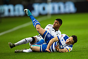Queens Park Rangers midfielder Marc Pugh (7) is tackled by Swansea City forward Rhian Brewster (19) during the EFL Sky Bet Championship match between Swansea City and Queens Park Rangers at the Liberty Stadium, Swansea, Wales on 11 February 2020.