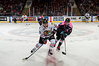 KELOWNA, CANADA - OCTOBER 21: Erik Gardiner #12 of the Kelowna Rockets checks Ilijah Colina #23 of the Portland Winterhawks as he skates with the puck over centre ice on October 21, 2017 at Prospera Place in Kelowna, British Columbia, Canada.  (Photo by Marissa Baecker/Shoot the Breeze)  *** Local Caption ***