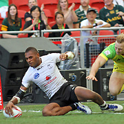 Jasa Veremalua scores a try in Fiji's 19-14 Quarter Cup victory over Australia in the Singapore 7's, day 2 finals, Singapore National Stadium, Singapore.  Photo by Barry Markowitz, 4/17/16