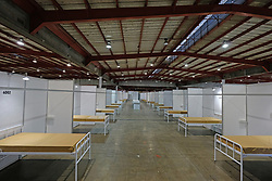 JOHANNESBURG, SOUTH AFRICA - APRIL 25: A ward of quarantine beds at the Nasrec quarantine site currently under construction. With isolation units, consultation areas, ICU capabilitiies, medical facilities, power points, drainage and ablutions the quarantine site has a total bed capacity of 2300 on April 25, 2020 in Johannesburg South Africa. Under pressure from a global pandemic. President Ramaphosa declared a 21 day national lockdown extended by another two weeks, mobilising goverment structures accross the nation to combat the rapidly spreading COVID-19 virus - the lockdown requires businesses to close and the public to stay at home during this period, unless part of approved essential services. (Photo by Dino Lloyd)