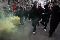 © Licensed to London News Pictures . FILE PHOTO DATED 26/03/2011 of a Black Bloc of protesters with a flare at a demonstration in London as reports circulate that black bloc tactics may be employed by protesters seeking to demonstrate during the funeral of former British Prime Minister Margaret Thatcher . Photo credit : Joel Goodman/LNP