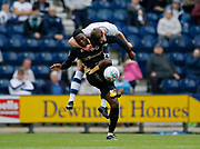Fred Onyedinma of Millwall and Paul Huntington of Preston North End contest an aerial ball during the EFL Sky Bet Championship match between Preston North End and Millwall at Deepdale, Preston, England on 23 September 2017. Photo by Paul Thompson.