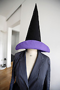 witches hat placed on top of a clothing fitting mannequin with jacket