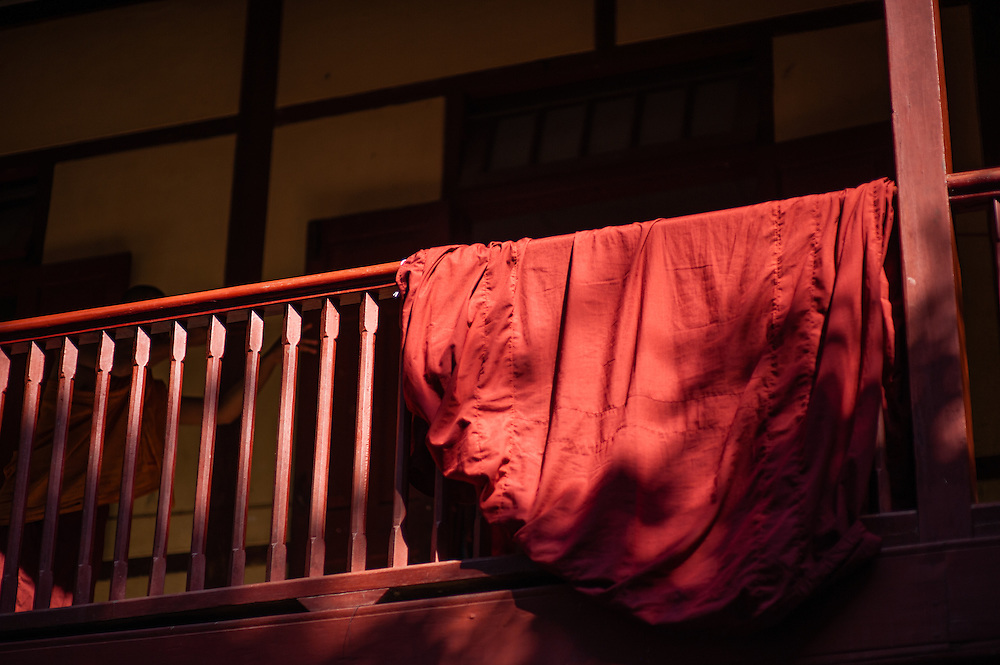 Buddhist monk robe hanging from balaustrade (Myanmar)