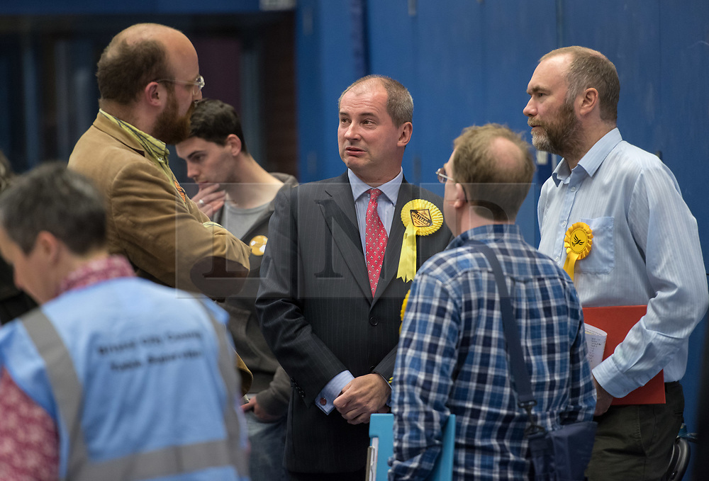 © Licensed to London News Pictures. 05/05/2017. Bristol, UK. STEPHEN WILLIAMS (centre), Lib Dem candidate for the mayoral election, at the Election Count at City Academy Bristol for the West of England Combined Authority Mayoral election 2017. The candidates are: Tim Bowles -Conservative Party; Aaron Warren Foot - UK Independence Party (UKIP); Darren Edward Hall - Green Party; Lesley Ann Mansell - Labour and Co-operative Party; John Christopher Savage - Independent; Stephen Williams - Liberal Democrats. Photo credit : Simon Chapman/LNP