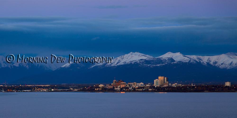 An evening sun illuminates downtown Anchorage, Alaska