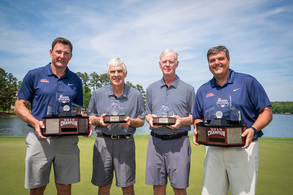 Ole Miss head football coach Matt Luke and Former Ole Miss tight end Wesley Walls pose for a photo, after winning the 2019 Chick-fil-A Peach Bowl Challenge, with Legends Division winners Bobby Jonson and Tom O'Brien at the Ritz Carlton Reynolds, Lake Oconee, on Tuesday, April 30, 2019, in Greensboro, GA. (Paul Abell via Abell Images for Chick-fil-A Peach Bowl Challenge)