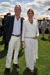 JAMES & the HON.MRS HOPKINS (SELINA) at the 27th annual Cartier International Polo Day featuring the 100th Coronation Cup between England and Brazil held at Guards Polo Club, Windsor Great Park, Berkshire on 24th July 2011.
