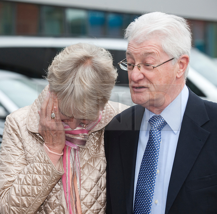 © Licensed to London News Pictures. 24/02/2012. Heathrow, UK. Elaine Tappin wiping a tear from her eye as she and her husband Christopher Tappin speak to the media outside Heathrow Police station before Christopher Tappin surrendered himself for extradition to the the USA. Christopher Tappin is charged with conspiring to export defence articles without licence or approval in relation to the sale of batteries that were allegedly used in Iranian surface-to-air missiles. Photo credit : Ben Cawthra/LNP
