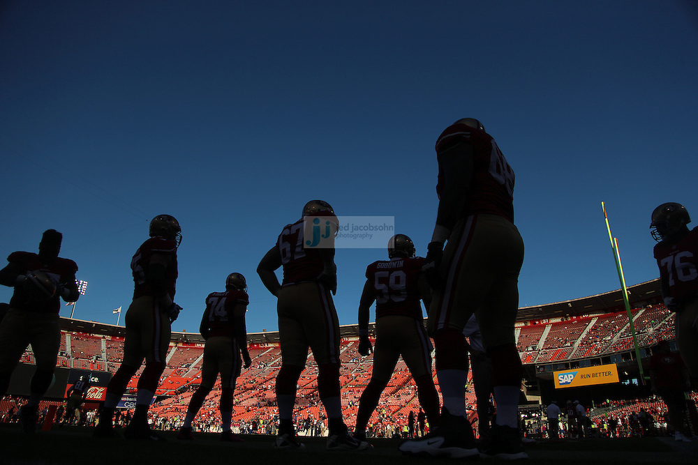 Members of the San Francisco 49ers warm up against the Seattle Seahawks on Thursday, Oct. 18, 2012 at Candlestick Park in San Francisco. (AP Photo/Jed Jacobsohn)