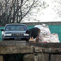 SHINIUJU, OCTOBER-26: a man unloads goods next to a car  in the China-bound port  in Shiniuju,October 26,2006.