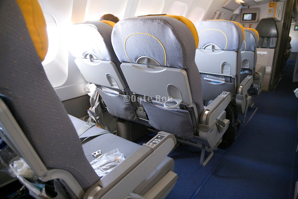 many empty seats in a commercial passenger airplane in flight
