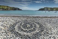 Pebble sculpture at Lulworth Cove in Dorset